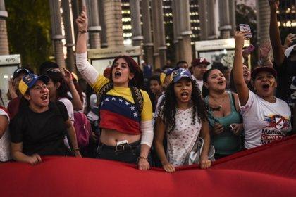 Manifestación en Medellín. La comunidad venezolana en Colombia es cada vez más grande, y en los últimos años creció la llegada de profesionales con mayor formación (AFP)