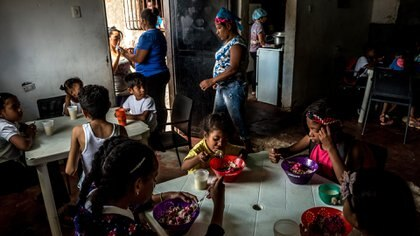 FILE - Children eat lunch at an Alimenta La Solidaridad soup kitchen sponsored by Feed the Solidarity in Caracas, Venezuela, Feb. 5, 2019. Government agents have raided the offices and frozen the bank accounts of the major Venezuelan food charity, threatening a lifeline for thousands of children during one of the world�s deepest humanitarian crises. (Meridith Kohut/The New York Times)