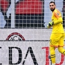 AC Milan's Italian goalkeeper Gianluigi Donnarumma reacts after conceding the opening goal during the Italian Serie A football match AC Milan vs Udinese on January 19, 2020 at the San Siro stadium in Milan. (Photo by Marco Bertorello / AFP)
