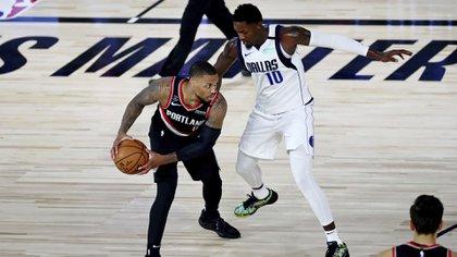 Lillard busca guiar a los Portland Trail Blazers a clasificar a los playoffs de la NBA (Foto: AP)