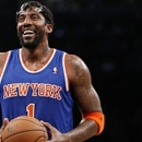 FILE - In this Dec. 5, 2013, file photo, New York Knicks forward Amare Stoudemire smiles before shooting a free throw during the team's NBA basketball game against the Brooklyn Nets in New York. Stoudemire retired Tuesday, July 26, 2016, after signing a contract with the Knicks with much less fanfare than the $100 million deal he inked six years ago to halt the team's downward spiral.
