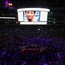 The picture of NBA great Kobe Bryant is seen on a screen during a public memorial for him, his daughter Gianna and seven others killed in a helicopter crash on January 26, at the Staples Center in Los Angeles, California, U.S., February 24, 2020. REUTERS/Lucy Nicholson
