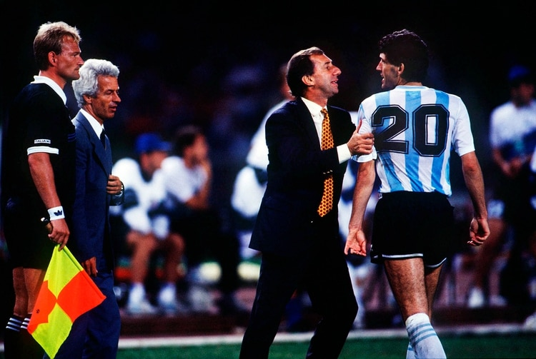 Mandatory Credit: Photo by Colorsport/Shutterstock (3121946a) Dr Carlos Bilardo (Argentinan Manager) restrains his player Juan Simon from the linesman Argentina v Italy World Cup Semi Final 1990 4/7/90 WC1990 SF: Argentina 1* Italy 1 Sport