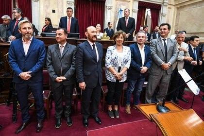 Rogelio Frigerio y el gobernador Gildo Insfran durante la jura de los senadores nacionales
