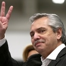 Presidential candidate Alberto Fernandez makes the victory sign as he attends voting at a polling station during the primary elections, in Buenos Aires, Argentina, August 11, 2019. REUTERS/Agustin Marcarian