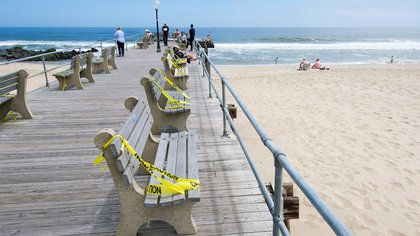 Benches are taped off with caution tape so they cannot be in Asbury Park, New Jersey, USA, on 22 May 2020. EFE/EPA/JUSTIN LANE