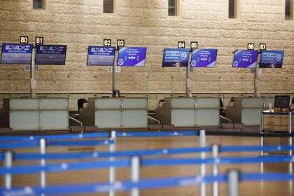 Empty El Al Israel Airlines check-in desks stand in the departures hall at Ben Gurion International airport in Tel Aviv, Israel, on Monday, Sept. 14, 2020. Financially strapped El Al Israel Airlines is planning a 505-million shekel share offer during the coming week, it said in a filing to the Tel Aviv Stock Exchange, the share offering a condition for the flagship carrier to secure a state bailout, including a $250 million loan guarantee. Photographer: Kobi Wolf/Bloomberg