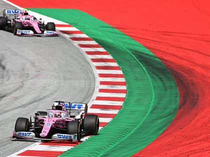 Formula One F1 - Steiermark Grand Prix - Red Bull Ring, Spielberg, Styria, Austria - July 12, 2020   Racing Point's Sergio Perez and Racing Point's Lance Stroll during the race, following the resumption of F1 after the outbreak of the coronavirus disease (COVID-19)    Joe Klamar/Pool via REUTERS