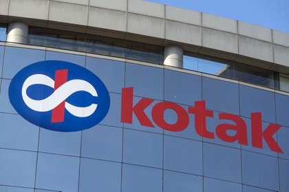 Kotak Mahindra Bank Ltd. logo is displayed at the company's head office at the Bandra Kurla Complex in Mumbai, India, on Sunday, Jan. 28, 2018. India's economy is expected to grow at 6.75 percent this year on the back of a recovery in second half of the year, Chief Economic Adviser Arvind Subramanian said in the Economic Survey presented in Parliament on Nov. 29. Photographer: Dhiraj Singh/Bloomberg