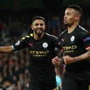 Soccer Football - Champions League - Round of 16 First Leg - Real Madrid v Manchester City - Santiago Bernabeu, Madrid, Spain - February 26, 2020 Manchester City's Gabriel Jesus celebrates scoring their first goal with Riyad Mahrez REUTERS/Sergio Perez