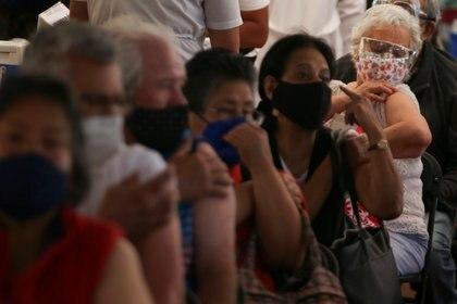 Elderly residents are pictured after receiving the AstraZeneca coronavirus disease (COVID-19) vaccine, at Olimpico Universitario stadium in Mexico City, Mexico April 12, 2021. REUTERS/Edgard Garrido