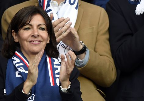 Paris' mayor Anne Hidalgo and French former President Nicolas Sarkozy (R) applaud before the French L1 football match Paris Saint-Germain (PSG) vs Montpellier Herault SC, on May 17, 2014 at the Parc des Princes stadium in Paris. AFP PHOTO / FRANCK FIFE        (Photo credit should read FRANCK FIFE/AFP/Getty Images)