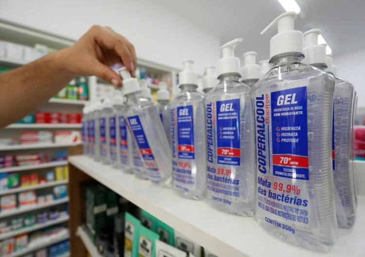 An employee from a pharmacy takes away an antibacterial gel, that is part of personal protection and survival equipment kits ordered by customers preparing against novel coronavirus in Porto Alegre, Brazil February 28, 2020. REUTERS/Diego Vara