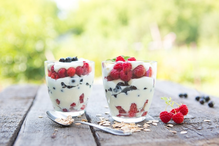 Natural yogurt with fresh raspberries, black currant and muesli. . Healthy dessert. Healthy food concept.