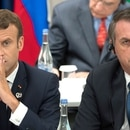 (FILES) In this file photo taken on June 28, 2019 France's President Emmanuel Macron (L) and Brazil's President Jair Bolsonaro attend a meeting on the digital economy at the G20 Summit in Osaka. - Brazilian President Jair Bolsonaro blasted his French counterpart Emmanuel Macron Thursday August 22 as having a