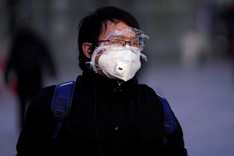 A passenger wearing a mask walks at the Shanghai railway station in China, as the country is hit by an outbreak of the novel coronavirus, February 9, 2020. REUTERS/Aly Song