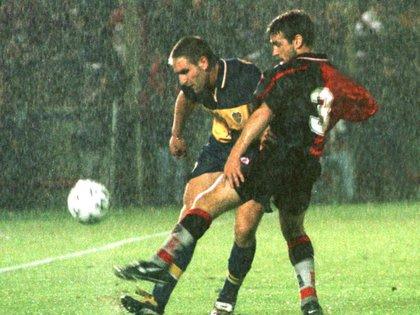 Fagiani pelea con Martín Palermo en un Newell's-Boca disputado en 1999 (FotoBaires)