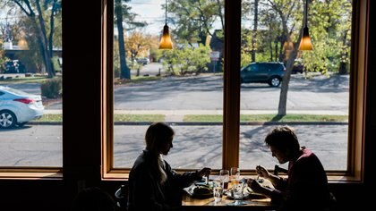 Diners at a restuarant in Wausau, Wis., Oct. 15, 2020. Exhaustion and impatience are creating new risks as cases soar in parts of the world. ÒThey have had enough,Ó one U.S. mayor said of her residents. (Gabriela Bhaskar/The New York Times)