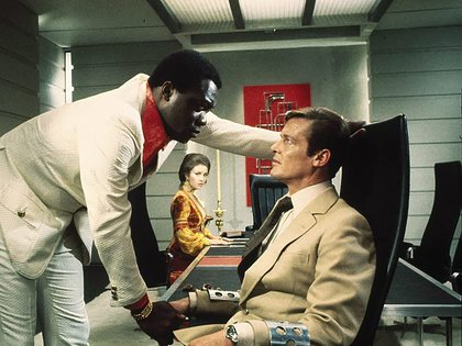 Yvette Kotto and Roger Moore as 007
