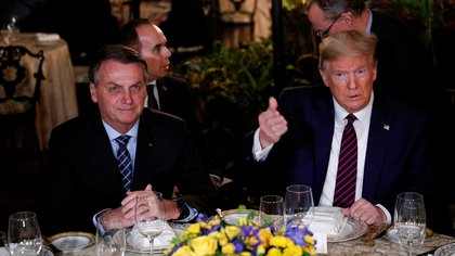 FILE PHOTO: U.S. President Donald Trump hosts a working dinner with Brazilian President Jair Bolsonaro at the Mar-a-Lago resort in Palm Beach, Florida, U.S., March 7, 2020. REUTERS/Tom Brenner/File Photo
