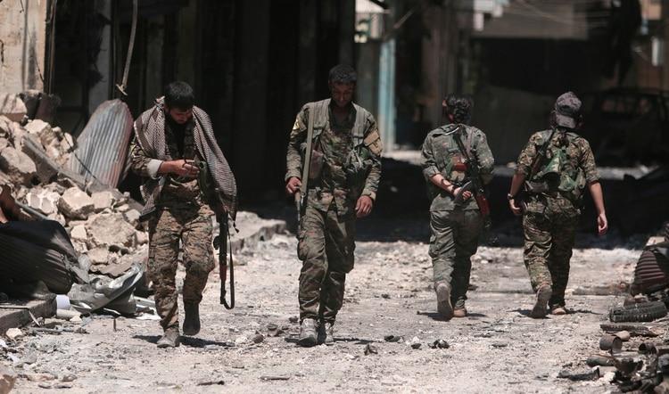 Miembros de las Fuerzas Democráticas Sirias en Manbij (Reuters)