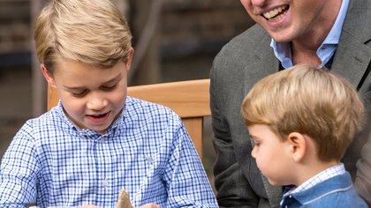 A handout photo released by Britain's Prince William and Cathrine, Duchess of Cambridge, of Prince William and Prince Louis watching as Prince George holds the tooth of a giant shark given to him by David Attenborough after Prince William and David Attenborough attended an outdoor screening of the upcoming Attenborough's feature film, in the gardens of Kensington Palace, in London, Britain, September 24, 2020. Picture taken September 24, 2020. Duke and Duchess of Cambridge/Kensington Palace/Handout via REUTERS THIS IMAGE HAS BEEN SUPPLIED BY A THIRD PARTY. NO RESALES. NO ARCHIVES MANDATORY CREDIT. NEWS EDITORIAL USE ONLY. NO COMMERCIAL USE. NO MERCHANDISING, ADVERTISING, SOUVENIRS, MEMORABILIA or COLOURABLY SIMILAR. NOT FOR USE AFTER 31 DECEMBER, 2020, WITHOUT PRIOR PERMISSION FROM KENSINGTON PALACE. THIS PHOTOGRAPH IS PROVIDED TO YOU STRICTLY ON CONDITION THAT YOU WILL MAKE NO CHARGE FOR THE SUPPLY, RELEASE OR PUBLICATION OF IT AND THAT THESE CONDITIONS AND RESTRICTIONS WILL APPLY (AND THAT YOU WILL PASS THESE ON) TO ANY ORGANISATION TO WHOM YOU SUPPLY IT. THERE SHALL BE NO COMMERCIAL USE WHATSOEVER OF THE PHOTOGRAPHS (INCLUDING BY WAY OF EXAMPLE ONLY) ANY USE IN MERCHANDISING, ADVERTISING OR ANY OTHER NON-NEWS EDITORIAL USE. THE PHOTOGRAPHS MUST NOT BE DIGITALLY ENHANCED, MANIPULATED OR MODIFIED IN ANY MANNER OR FORM AND MUST INCLUDE ALL OF THE INDIVIDUALS IN THE PHOTOGRAPH WHEN PUBLISHED. ALL OTHER REQUESTS FOR USE SHOULD BE DIRECTED TO THE PRESS OFFICE AT KENSINGTON PALACE IN WRITING.