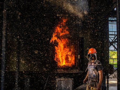 **EMBARGO: No electronic distribution, Web posting or street sales before 2:31 a.m. ET TUESDAY, JAN. 25, 2021. No exceptions for any reasons. EMBARGO set by source.** Sugar cane fiber is burned to heat cane juice at the Biobando trapiche facility in Valle del Cauca, Colombia on Oct. 8, 2020. Makers of Latin America's favorite traditional sweetener say a sugar engineer wants exclusive control of their centuries-old product. (Federico Rios/The New York Times)