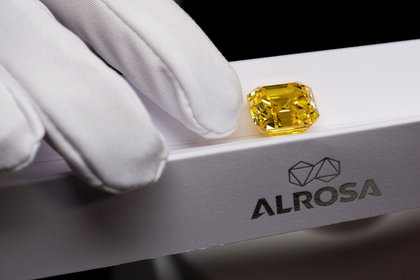 The largest stone in the exhibition was a deep yellow asscher cut diamond, weighing 20.69 carats. It was cut from a raw crystal with a rare honey hue, which weighed 34.17 carats and was the largest yellow diamond mined in Russia in 2017. Moscow, Russia, February 13, 2019. ALROSA Exhibits Largest Pink Diamond in Companys History. ALROSA, the biggest diamond producer in the world, has conducted a media preview of the collection of large coloured diamonds, including unique pink, bright yellow and pink purple gems.