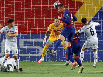 Soccer Football - Champions League - Round of 16 Second Leg - FC Barcelona v Napoli - Camp Nou, Barcelona, Spain - August 8, 2020  Barcelona's Clement Lenglet scores their first goal, as play resumes behind closed doors following the outbreak of the coronavirus disease (COVID-19)  REUTERS/Albert Gea