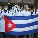 An emergency contingent of Cuban doctors and nurses arrive at Italy's Malpensa airport after travelling from Cuba to help Italy battle the spread of coronavirus disease (COVID-19), near Milan, Italy, March 22, 2020. REUTERS/Daniele Mascolo