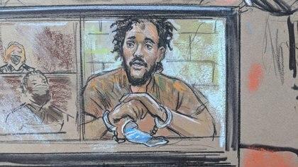El Shafee Elsheikh se muestra en una pantalla durante la audiencia virtual en el Tribunal de Distrito de los Estados Unidos en Alexandria, Virginia, el 7 de octubre de 2020 (Bill Hennessy vía REUTERS)