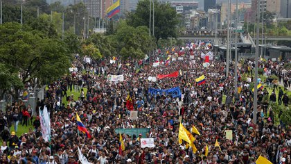 Anti-government demonstrators march during a nationwide strike in Bogota, Colombia, Thursday, Nov. 21, 2019. Colombia's main union groups and student activists called for a strike to protest the economic policies of Colombian President Ivan Duque government and a long list of grievances. (AP Photo/Ivan Valencia)