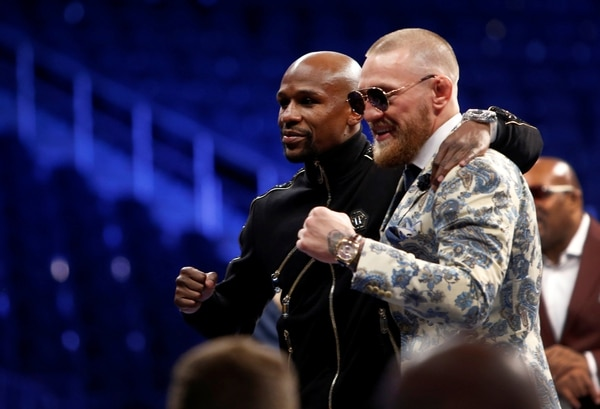 Undefeated boxer Floyd Mayweather Jr. (L) of the U.S. and UFC lightweight champion Conor McGregor of Ireland pose during post-fight news conference at T-Mobile Arena in Las Vegas, Nevada, U.S. August 27, 2017. REUTERS/Steve Marcus