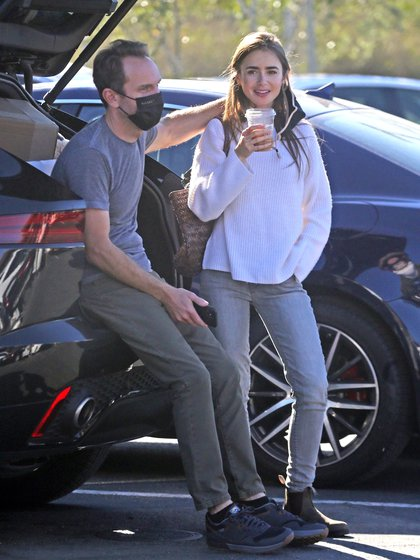 A different date. Lily Collins and her fiancé, Charlie McDowell, enjoyed coffee sitting in the trunk of their truck before heading to a recycling center in Santa Barbara, California. They were seen entertaining and chatting, both wearing masks, except for the actress when she had her coffee