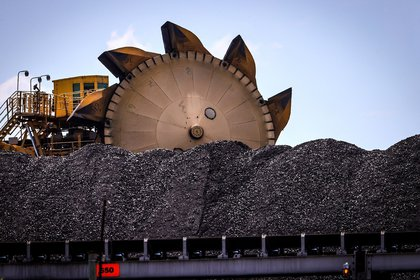 A bucket-wheel reclaimer stands next to a pile of coal at the Port of Newcastle in Newcastle, New South Wales, Australia, on Monday, Oct. 12, 2020. Prime Minister Scott Morrison warned last month that if power generators don't commit to building 1,000 megawatts of gas-fired generation capacity by April to replace a coal plant set to close in 2023, the pro fossil-fuel government would do so itself. Photographer: David Gray/Bloomberg