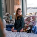 Maggie Flannery and both her parents fell ill with Covid-19 symptoms in March, when testing was still scarce. Months later, she's had to limit her activities and has trouble concentrating. (Brittainy Newman for The New York Times)