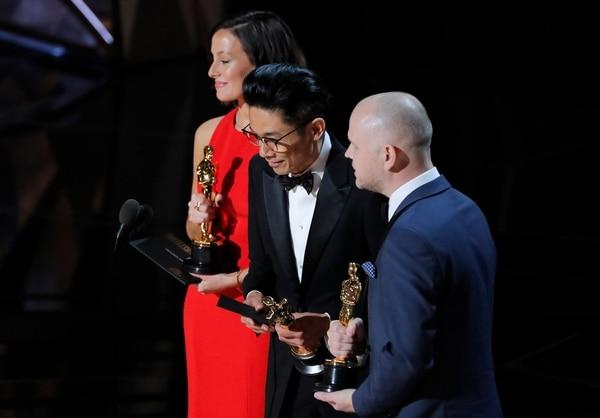 Lucy Sibbick, Kasuhiro Tsuji y David Molinowski (Reuters)
