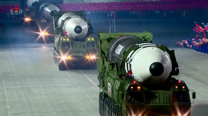 """A screen grab taken from a KCNA broadcast on October 10, 2020 shows North Korean Hwasong-15 intercontinental ballistic missiles during a military parade marking the 75th anniversary of the founding of the Workers' Party of Korea, on Kim Il Sung square in Pyongyang. - Nuclear-armed North Korea held a giant military parade, television images showed, with thousands of maskless troops defying the coronavirus threat and Pyongyang expected to put on show its latest and most advanced weapons. (Photo by - / KCNA VIA KNS / AFP) / - South Korea OUT / REPUBLIC OF KOREA OUT   ---EDITORS NOTE--- RESTRICTED TO EDITORIAL USE - MANDATORY CREDIT """"AFP PHOTO/KCNA"""" - NO MARKETING NO ADVERTISING CAMPAIGNS - DISTRIBUTED AS A SERVICE TO CLIENTSTHIS PICTURE WAS MADE AVAILABLE BY A THIRD PARTY. AFP CAN NOT INDEPENDENTLY VERIFY THE AUTHENTICITY, LOCATION, DATE AND CONTENT OF THIS IMAGE. /"""