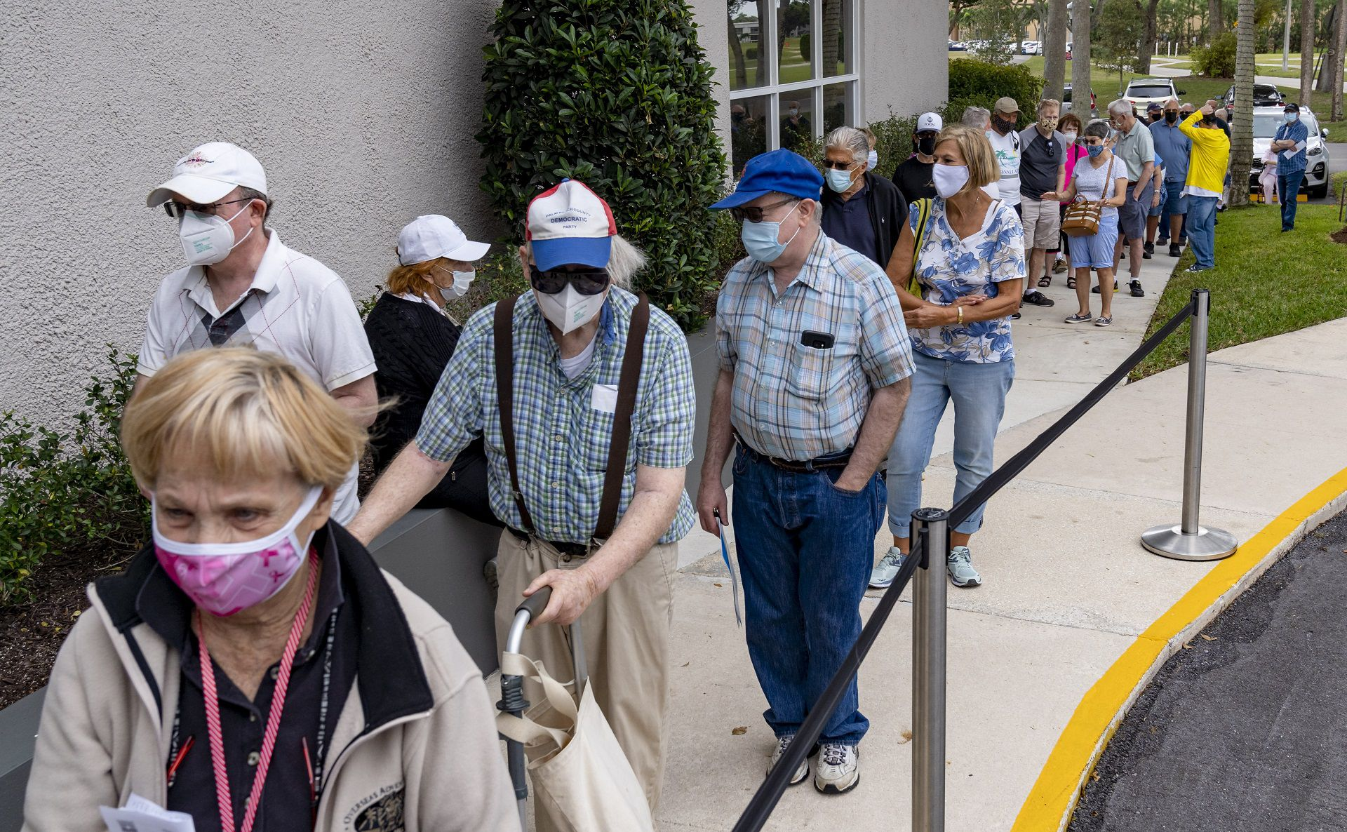 Seniors stand in line to make an appointment to receive the Moderna COVID-19 vaccine outside the King's Point clubhouse in Delray Beach, Florida on December 30, 2020. (Greg Lovett/The Palm Beach Post)/The Palm Beach Post via AP) /The Palm Beach Post via AP)