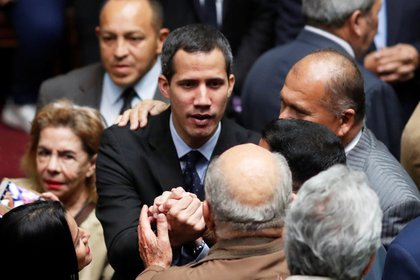 Venezuelan opposition leader and self-proclaimed interim president Juan Guaido attends a session of the Venezuela's National Assembly in Caracas, Venezuela January 29, 2019. REUTERS/Carlos Garcia Rawlins