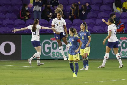 Jan 22, 2021; Orlando, Florida, USA;  the United States midfielder Catarina Macario (29) jumps in celebration after scoring a goal as midfielder Rose Lavelle (16) and forward Lynn Williams (6) come into celebrate as Colombia midfielders Jessica Caro (8) and Daniela Montoya (6) look on during the first half at Exploria Stadium. Mandatory Credit: Reinhold Matay-USA TODAY Sports