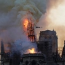 The steeple and spire engulfed in flames collapses as the roof of the Notre-Dame de Paris Cathedral burns on April 15, 2019 in Paris. - A colossal fire swept through the famed Notre-Dame Cathedral in central Paris on April 15, 2019, causing a spire to collapse and raising fears over the future of the nearly millenium old building and its precious artworks. The fire, which began in the early evening, sent flames and huge clouds of grey smoke billowing into the Paris sky as stunned Parisians and tourists watched on in sheer horror. (Photo by Geoffroy VAN DER HASSELT / AFP)