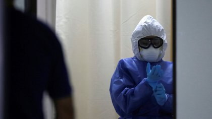 A healthcare worker prepares to collect swab samples from a man to be tested for the coronavirus disease (COVID-19) at a public hospital, in Monterrey, Mexico July 14, 2020. REUTERS/Daniel Becerril