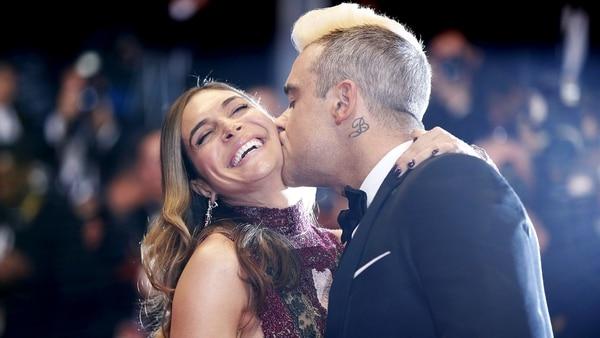 Robbie Williams y Ayda Field (AFP)