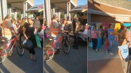 A finales de abril, a plena luz del día y en un sitio concurrido por las autoridades de Jalisco, integrantes del CJNG entregaron despensas a poblaciones vulnerables (Foto: Captura de pantalla)