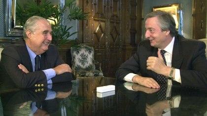 Esteban Righi junto al ex presidente Néstor Kirchner (NA)