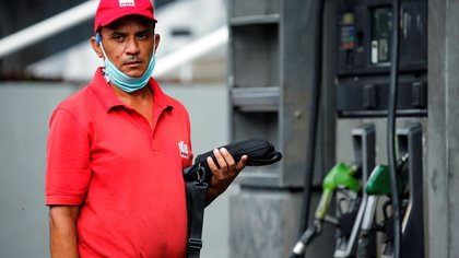 A worker of a gas station looks on, after Venezuela's government launched new fuel pricing system, in Caracas, Venezuela June 1, 2020. REUTERS/Manaure Quintero