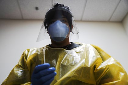 The COVID-19 response specialist Alexandra Vizcarra prepares to administer a nasal swab test at Public Health Madison & Dane County as the coronavirus disease (COVID-19) outbreak continues in Madison, Wisconsin, U.S., October 19, 2020. REUTERS/Bing Guan