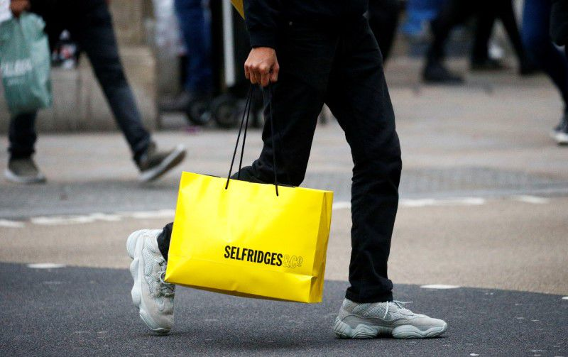 FILE PHOTO: People shopping on Oxford Street in central London, Britain, December 20, 2018. REUTERS/Henry Nicholls
