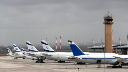 FILE PHOTO: El Al Israel Airlines planes are seen on the tarmac at Ben Gurion International airport in Lod, near Tel Aviv, Israel March 10, 2020. REUTERS/Ronen Zvulun/File Photo